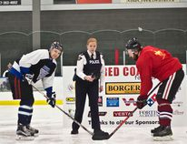 Airdrie RCMP detachment commander Kimberly Pasloske drops the puck for the final game of the RCMP Red Coats for Kids tournament at Genesis Place on Jan. 26, 2018.