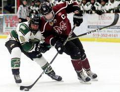 Chatham Maroons captain Noah Bushnell (55) shoots while being checked by St. Thomas Stars' Adam Keyes (10) in the first period at Chatham Memorial Arena in Chatham, Ont., on Thursday, Feb. 1, 2018. (MARK MALONE/Chatham Daily News/Postmedia Network)