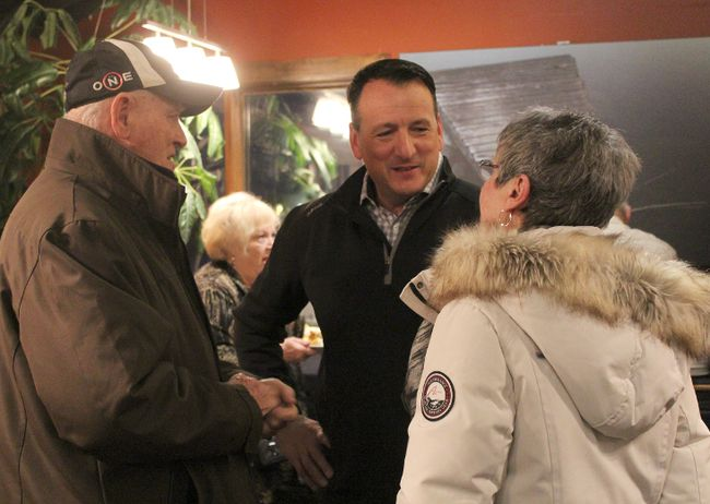 Kenora-Rainy River Ontario PC candidate Greg Rickford talks with two members of the public at a meet-and-greet event at Casey's Bar and Grill on Wednesday, Jan. 31.