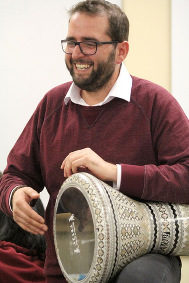 George Alkhoury, from Lebanon, demonstrates traditional drumming during a multicultural day at Sault Community Career Centre on Friday.