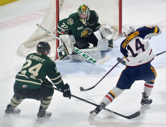 Barrie Colts forward Andrei Svechnikov gets the shot off at London Knights goaltender Joseph Raaymakers and defenceman Andrew Parrott during an Ontario Hockey League game at Budweiser Gardens on Friday, February 2, 2018. (MORRIS LAMONT, The London Free Press)