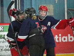 St. Joseph's Panthers, including Kate Villeneuve, at right, and Kayla Groulx, at left, celebrate St. Joe's first of three consecutive shorthanded goals against North Dundas on Monday. The Panthers defeated North Dundas 5-2 to improve to 5-0 in SD&G girls high school hockey league play. Kevin Gould/Cornwall Standard-Freeholder