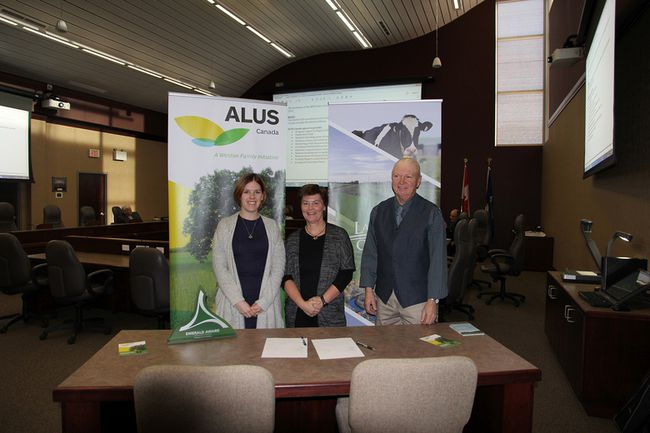 Lacombe County Reeve Paula Law, centre, stands with representatives from ALUS Canada at the County Administration building during the announcement of the partnership between ALUS and the county last January. (Photo submitted)