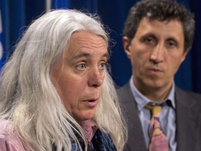 Quebec Solidaire MNA Manon Masse (left) responds to a reporter's question at the legisature in Quebec City on Thursday, May 29, 2014 as colleague Amir Khadir, right, looks on. Jacques Boissinot / THE CANADIAN PRESS