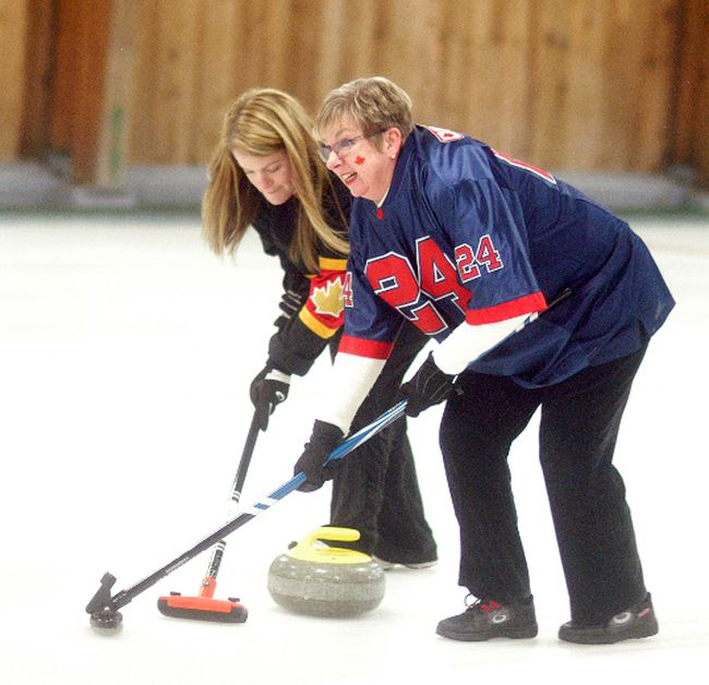 Suzy and Janice Gurd team up to sweep at the Chatham-Kent Health Alliance Foundation's Charity Curling Classic held on Saturday at the Sydenham Community Curling Club. The event had an Olympic theme and raised money for the CKHA Diagnostic Imaging Equipment Renewal Campaign.