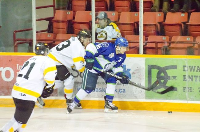 The Melfort Mustangs' Kalem Zary attempts to escape from a Nipawin Hawks' player during the Mustangs' 3-2 shootout win over the Hawks on Friday, February 2 at the Northern Lights Palace.