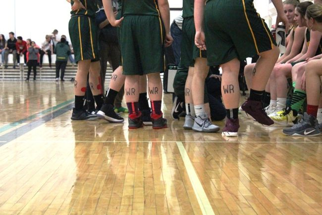 After learning of the sudden passing of teacher Wade Rolles the MUCC Comets' senior girls basketball team paid tribute in their own way. The team wore his initials on their legs as they went on to win the title at the Penny Anderson Invitational Tournament at MUCC on Saturday, February 3.