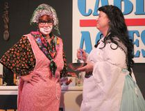 Mary Lynn Quashnick (left) gets a face full of whipped cream from Gwen Snell as the duo take on the identities of Isobel and Dolly during the Stage Hanna production of Kitchen Witches on Friday.