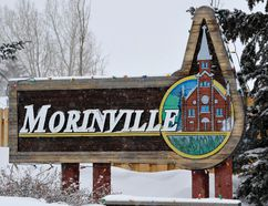 FILE PHOTO - A sign with an image of a church at the entrance to Morinville is seen in 2011.
