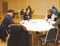 Nanton Mayor Jennifer Handley, second from left, speaks with local residents during the Town council's public engagement session Jan. 28 at the Nanton Community Memorial Centre. Jasmine O'Halloran Postmedia Network