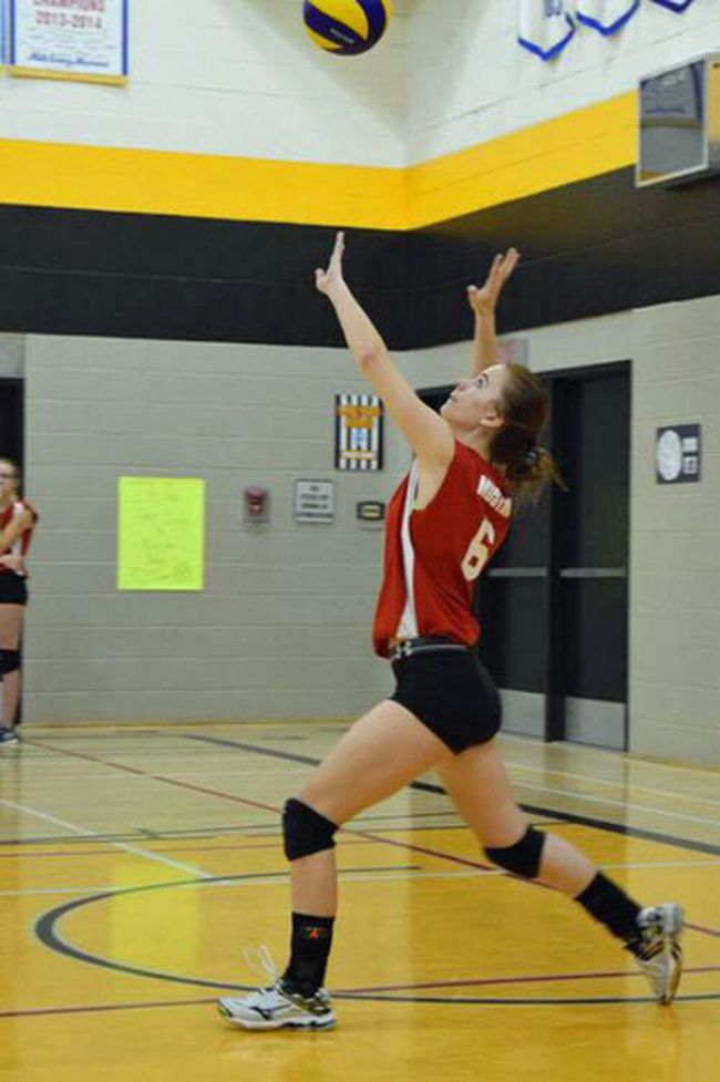 MacGregor, Manitoba's Emily Nichol serving a ball this volleyball season. She'll be suiting up for the ACC Cougars in Brandon next fall. (supplied photo)