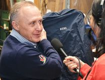 During an interview with CBC Radio's Q, Stratford Perth Museum general manager John Kastner shows producer Elaine Chau Justin Bieber's hockey jacket, which will be on display in the museum's Steps to Stardom exhibit, opening Feb. 18. (Galen Simmons/The Beacon Herald)