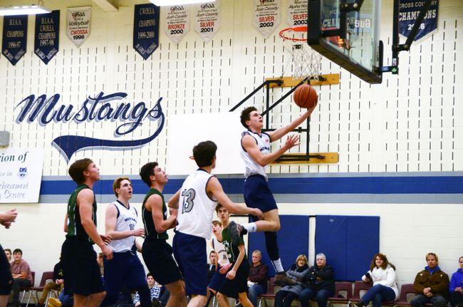 Hugh Weichel flies through the lane for the finger-roll during the first quarter of the St. Mary's Mustangs 45-42 win over the Grey Highlands Lions in BAA senior boys basketball action Tuesday in Owen Sound. Greg Cowan/The Sun Times.