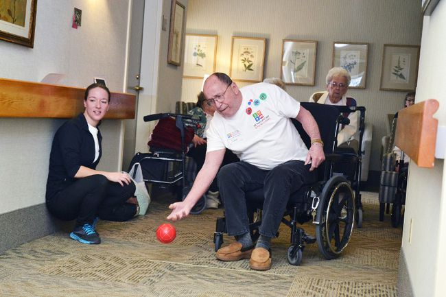 Kicking off Wednesday's bocce ball tournament at Cedarcroft Place Retirement Residence, John Sauve takes the first throw. The tournament was held as part of the week-long Seniors Games. (Galen Simmons/The Beacon Herald)