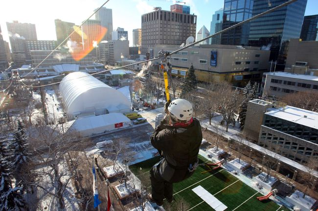 FILE PHOTO - A CFL fan tries the zipline at the 2010 Grey Cup Festival in downtown Edmonton. That attraction plus many others were announced for this fall's bash on Jasper Avenue.