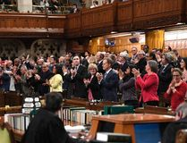 Liberal MPs rise for a standing ovation after Speaker of the House of Commons Geoff Regan stated that Bill C-210 had received royal assent, at the conclusion of Question Period in the House of Commons on Parliament Hill in Ottawa on Wednesday, Feb. 7, 2018. THE CANADIAN PRESS/Justin Tang