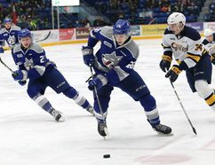 Anthony Tabak, middle, of the Sudbury Wolves, attempts to evade Jack Duff, of the Erie Otters, during OHL action at the Sudbury Community Arena in Sudbury, Ont. on Friday February 2, 2018. John Lappa/Sudbury Star/Postmedia Network