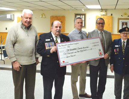 Photo by KEVIN McSHEFFREY/THE STANDARD St. Joseph Foundation co-chair Brian Cardy, Legion branch 561 president Tom Hywarren, hospital chief of staff Dr. Tim deBortoli, St. Joseph's General Hospital CEO Pierre Ozolins, and Legion branch's second vice-president Irene Ducet with a $6,500 cheque.