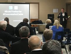 MPP Jeff Yurek (Elgin-Middlesex-London) speaks to a crowd at a town hall meeting in Lambeth on Wednesday night. The meeting centred around the timeline for installing concrete median barriers on a stretch of Highway 401 between London and Tilbury. The province announced on Monday it would build those barriers after a renewed environmental assessment. (MEGAN STACEY, The London Free Press)