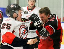 Bronson Spearing, #22, of the Blackfalds Wranglers gets into a fight with Brett Campbell of the Airdrie Thunder during Tuesday night Heritage Junior Hockey League action at the Blackfalds Multi-plex Arena. The Wranglers won 7-3 over the Thunder. (Ashli Barrett/Lacombe Globe)
