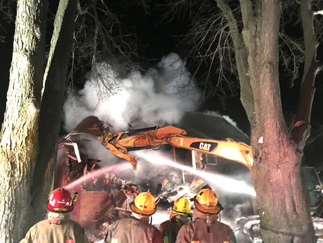 Firefighters with the Chatham-Kent Fire and Emergency Services are shown at the scene of a vacant farm house fire on Old Street Line in Blenheim which started Thursday evening. (Handout/Postmedia Network)