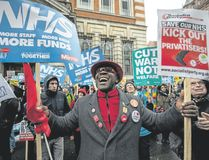 Demonstrators participate in a protest against the Conservative government's health policy on Feb. 3 in London, England. (Chris J Ratcliffe/Getty Images)