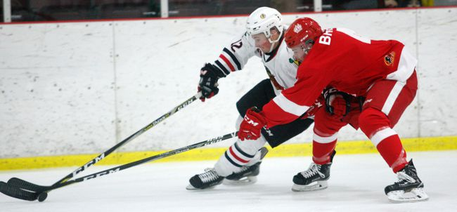 Brockville Braves Joshua Spratt tries to fend of Pembroke Lumber Kings Jake Brien during Friday's game at the memorial Centre. (Jonathon Brodie/The Recorder and Times)