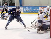 Photo by Russ Ullyot, Postmedia Network Canmore Eagles' Justin Giacomin takes a shot on goal during an AJHL game against the Spruce Grove Saints at the Canmore Recreation Centre on Friday.