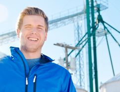 Matthew Vanheule, 19, stands in front of grain elevator legs currently operating as a makeshift wireless internet tower. With his company MPV Wifi, his goal is to bring affordable high-speed internet to rural Ontario with infrastructure already in place. (LOUIS PIN, Times-Journal)