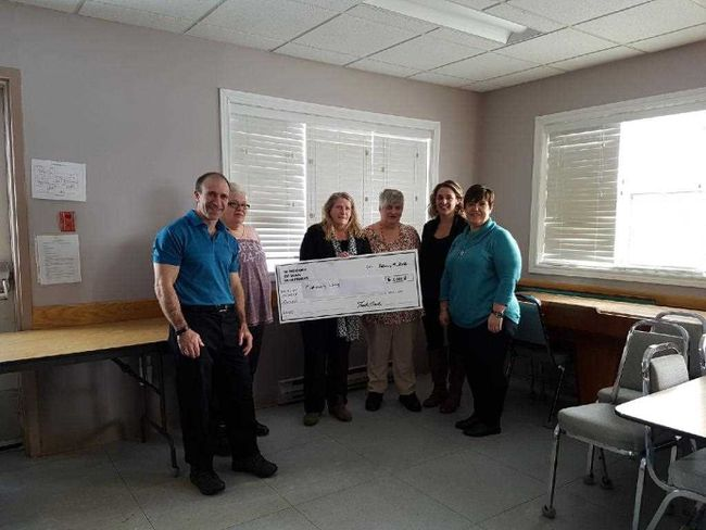 At the cheque presentation to the North East Association for Community Living  was Frank Louvelle, Lise Proulx, Leona Dumoulin, Ginette Papineau, Veronique Shanks and Nathalie  Côté-Tremblay.