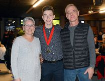 Shown here is Matthew Markell with his parents, Stephanie and Vernon, during a fundraiser at Boomer's on Saturday. (Sabrina Bedford/The Recorder and Times)