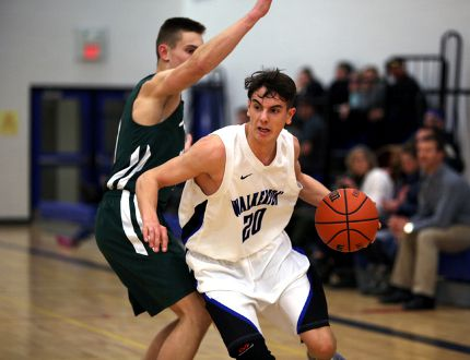 Ethan Cudney of the Walkerton Riverhawks drives past the Kincardine Knight's Shayne McCarthy in the first quarter of the Riverhawks 61-35 Bluewater Athletic Association championship win Tuesday evening in Walkerton. Greg Cowan/The Sun Times