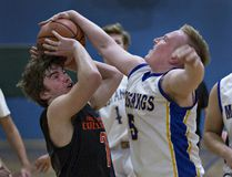 Dantae Bisson (left) of North Park Collegiate is denied a shot at the hoop by Aidan Vachon of Brantford Collegiate Institute during Game 1 of high school junior boys basketball final on Tuesday. (Brian Thompson/The Expositor)