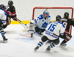 Joel Pavey and Cameron Hough of the Sarnia Legionnaires storm the London Nationals net in a Jr. 'B' hockey contest won 4-2 Tuesday by the Legionnaires.