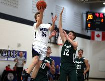 The Riverhawks' Evan Visser drives for a layup as the Knights' Dax Tompkins tries for the block in the first quarter of the Riverhawks 61-35 Bluewater Athletic Association championship win Tuesday evening in Walkerton. Greg Cowan/The Sun Times