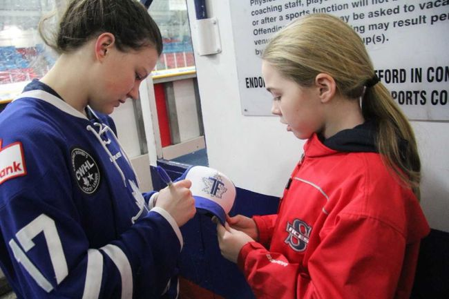 Emily Fulton signs an autograph after her Toronto Furies played at the Allman Arena in Stratford last season. Fulton was named Canadian Women's Hockey League Player of the Month for January. (Cory Smith/The Beacon Herald)