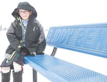 KASSIDY CHRISTENSEN HIGH RIVER TIMES/POSTMEDIA NETWORK. Cole Russell sits on the buddy bench he helped bring to the École Joe Clark School playground.