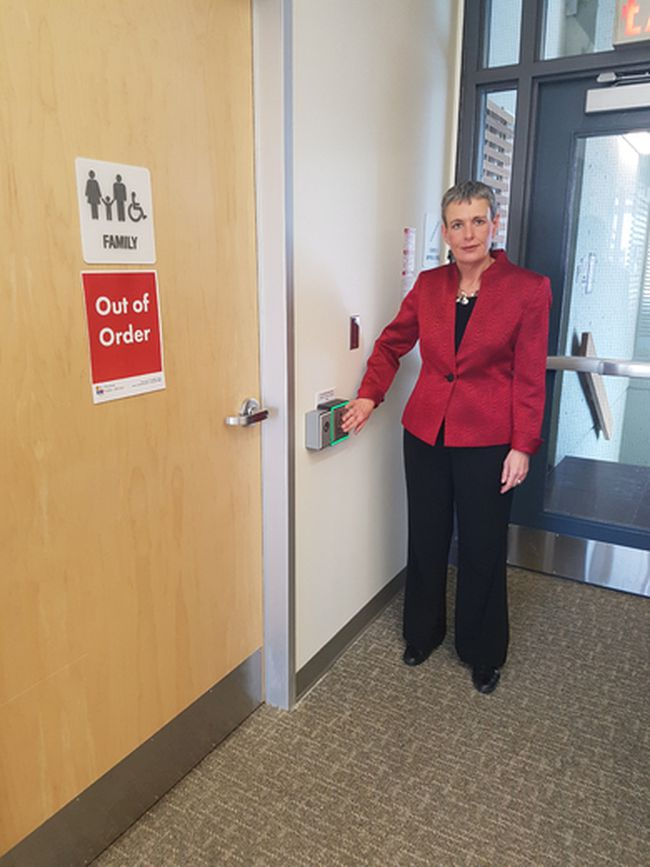 Chief executive Heather Robinson shows off the locks that have been placed on the washroom doors at the St. Thomas public library. The doors have had to be locked as people are using drugs in the washrooms. City hall across the street is having the same issue. (Laura Broadley/Times-Journal)
