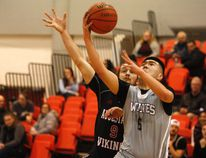 GORDON ANDERSON/DAILY HERALD-TRIBUNE GPRC Wolves basketball player Chris Noh attempts a lay-up in recent Alberta Colleges Athletic Conference action against the Augustana Vikings. The Wolves will close out the regular season this weekend when they face the NAIT Ooks in Edmonton.