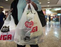 In this file photo, a woman leaves a grocery store in Montreal carrying plastic bags on Friday, May 15, 2015. Ryan Remiorz / THE CANADIAN PRESS