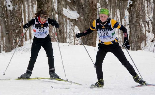 St. Mike's Elizabeth Drake (right) and St. Marys DCVI's Sarah Black compete in the senior girls division at the WOSSAA Nordic championships this week. (Mark Dewan photo)