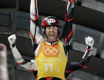 Canada's Tristan Walker and Justin Snith — half of a luge relay team that narrowly missed a medal at Sochi in 2014 — exult after the same squad's silver medal-winning run at the 2018 Winter Games in Pyeongchang, S. Korea, Thursday. (Andy Wong/The Associated Press)