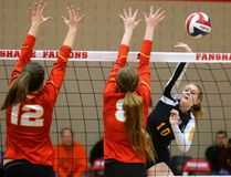 Hannah Petcoff of the Oakridge Oaks hits past the block of Marielle Kleuskens and Maxine Graham of the Saunders Sabres during the TVRA AAA senior girls volleyball final at Fanshawe College on Thursday night. The Oaks put on a defensive clinic in winning the championship 25-21, 25-8, 25-14. The Oaks advance to the WOSSAA AAA final next week. (MIKE HENSEN, The London Free Press)