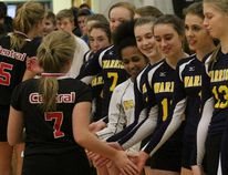 Stratford Central's Grace Neely (7) and Cortney Groenestege (5) make their way through a line of St. Mike's players after the Warriors won the Huron-Perth junior girls volleyball final in four sets. (Cory Smith/The Beacon Herald)