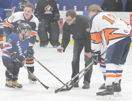 KASSIDY CHRISTENSEN HIGH RIVER TIMES/POSTMEDIA NETWORK. Mayor Craig Snodgrass dropped the ceremonial puck on the Rally for Kraft Hockeyville 2018 Big N' Lil' Kids Community Hockey Game held Feb. 11 at the Bob Snodgrass Recreation Complex.