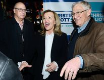 Ontario Progressive Conservative leadership candidate Christine Elliott talks with Oxford MPP Ernie Hardeman, right, a 23-year Queen's Park veteran, and Rob Flack during a meeting Friday with area Conservatives at Joe Kool's bar in London. (MORRIS LAMONT, The London Free Press)