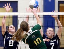 Ursuline Lancers' Erin Horner (8) and Abbey Piatkowski (7) try to block Emilie Thiffeault (10) of the St. Patrick's Fighting Irish during the LKSSAA 'AAA' senior girls' volleyball final at Ursuline College Chatham in Chatham, Ont., on Friday, Feb. 16, 2018. (MARK MALONE/Chatham Daily News/Postmedia Network)