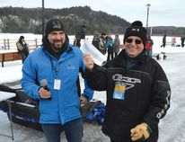 Photo by KEVIN McSHEFFREY/THE STANDARD Elliot Lake Mayor Dan Marchisella presents Ron Nadon, the winner of the 11th annual Elliot Lake Ice Fishing Derby, with his winnings, a cheque of $24,950. Nadon, a long-time Elliot Lake resident, won with a 67.5-centimetre (26.6-inch) pike. This was only his second time in this fishing derby.