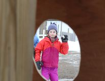 Lily Bence wind up and toss a baseball size handful of snow towards the target.