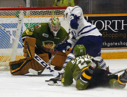 North Bay Battalion goalie Christian Propp eyes the puck as Mississauga Steelheads forward Mathieu Foget (93) attempts an overtime score with Troops forward Adam McMaster back-checking at Memorial Gardens, Sunday. Dave Dale / The Nugget